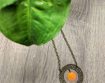 Antiqued brass and bright orange seashell necklace