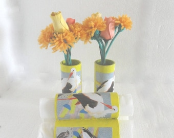 Floral vases and napkin rings matching Stork for festive table