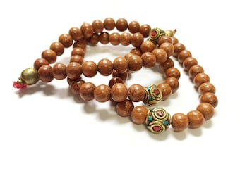 Chant bracelet - a mala-style warm wood and Tibetan turquoise and coral brass bead