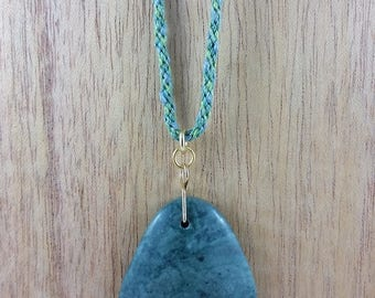 Necklace: green marble; green stone pendant on braided silk cord