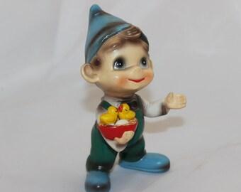 Vintage Little Porcelain Smiling Boy Figurine holding Two Chicks and an Egg Elf