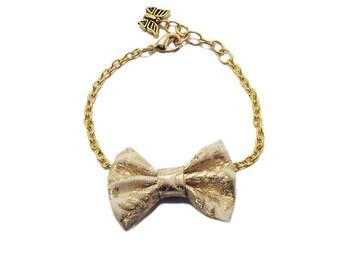 Bow tie fabric Retro gold chain bracelet.