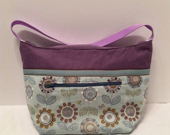 "LIP9- Lunch Bag: ""Flora Fun"" washable insulated lunch bag with zippered front pocket and zippered top closure."
