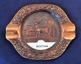 """Copper """"Montana"""" Ashtray Ashtray with Picture of a Buck in the Center and Flowers Around the Rim - Montana Souvenir - State Memorabilia"""