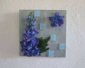 Table with artificial flowers, blue delphinium, collage, spring, 3D, floral arrangement, wedding gift