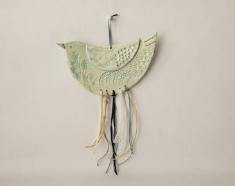 Ceramic bird to hang with ribbons and laces, enamel in shades of pastel, pale green, blue, beet prints