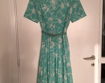 70s does 50s turquoise dress