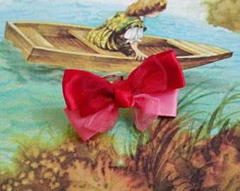 Red and pink ribbon bow ring