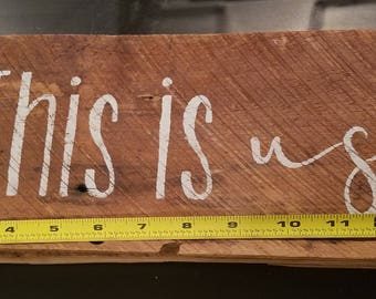 This is us painted sign on reclaimed wood