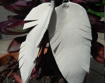 Leather ivory feather shape earrings