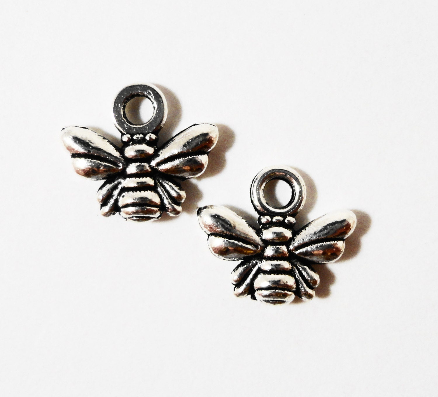 50pcs silver bee charms 10x10mm antique silver honey bee charms 50pcs silver bee charms 10x10mm antique silver honey bee charms bumble bee charm insect charm bee pendant wholesale metal charms bulk charms aloadofball Choice Image