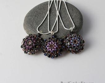 Beadwoven mandala pendant in black and purple