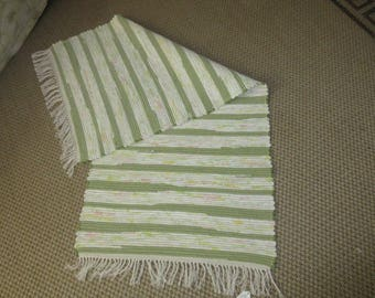 Woven 5ft by 25 inch pea green striped rag rug.  JW203