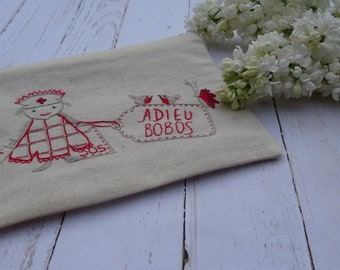 "Clutch in need of first aid ""Farewell Bobos"" hand embroidered"