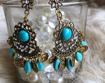 Gold tone and turquoise looking stone