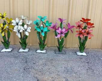 Colorful metal flowers. metal flowers. rustic metal flowers. garden decorations. colorful flowers.