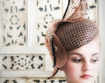 Designer hat handmade, in bronze lattice sinamay with applique detail.