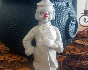 SALE...Duncan Royale Clown Holding Mask