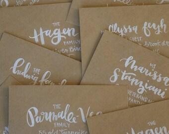 envelope addressing | white brush lettering on kraft