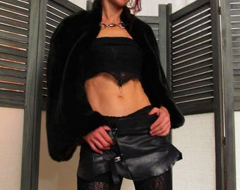 skirt made of smooth semi matte or semi gloss black tie straps or buckles