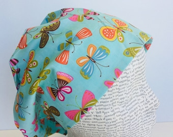 European Scrub Cap scrub hat with a light blue material with colorful butterflies