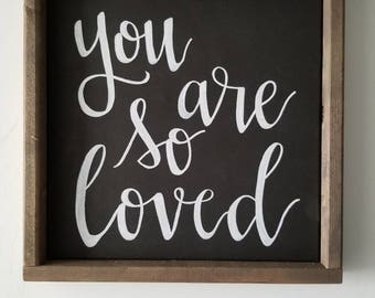 "Rustic hand painted ""you are so loved"" white hand lettering on black canvas, custom solid wood framed home decor sign"