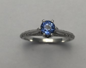 Style#300-14KT solid white gold Blue Sapphire ring  set with 4 mm round.