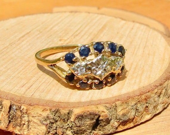 A vintage 18k yellow gold diamond and sapphire ring
