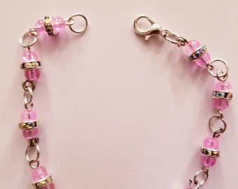 Pink and jeweled silver beaded bracelet