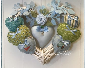 Bow birth 8 hearts in wicker with Hearts on the green/blue tones