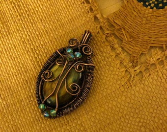 """Intricate wire woven Labradorite Pendant with Swarovski Crystals.   Labradorite property is """"Bringer of Light""""."""