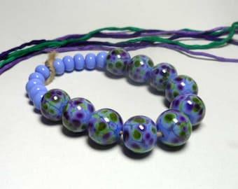 Lampwork.Glass bead handmade.Beads cornflower blue, green, purple.
