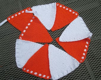 Hand knitted bunting in  orange and white