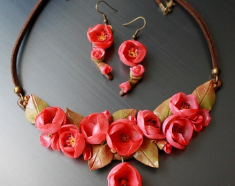 Necklace and earrings in pink cherry blossoms (chaenomeles japonica)