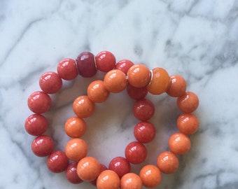 Orange and or Red semi precious beaded bracelet with pandora style bead.
