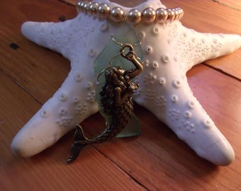 handmade light green sea glass pendant necklace with bronze mermaid and pearls