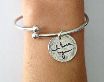 Actual writing on Silver Cuff Bracelet with Charm