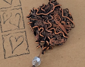 Organic copper necklace incorporating wire weaves and coils