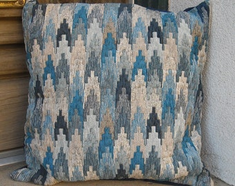 Contemporary southwestern style pillow cover in a mixture of blues.  Colors range from deep indigo, through soft denim to cool greys