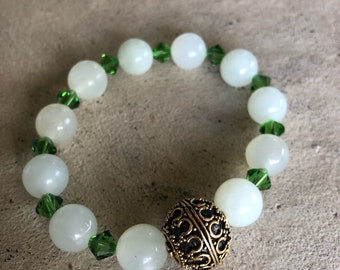 Quartz and crystal bracelet with Gold bead from Bali.  Was for St. Patricks day, so now marked down.