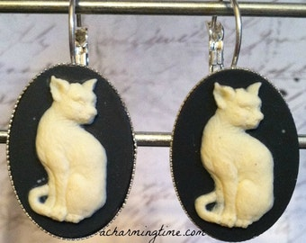 Earrings with an Ivory Kitty Cat on a Black Colored Cameo on Lever Back Hooks