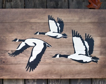 Rustic wooden sign 'Geese in Flight' artistic decor