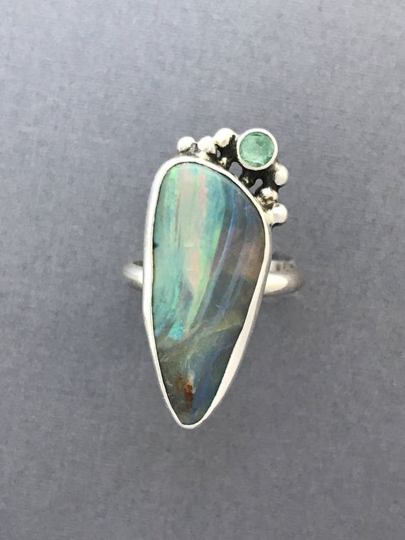 Exquisite Australian boulder opal with apatite ring