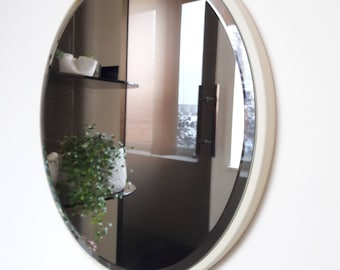 Simple round wall mirror