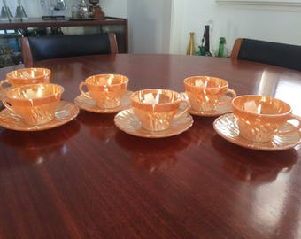Anchor Hocking Fire King Suburbia peach lustre swirl cup and saucers