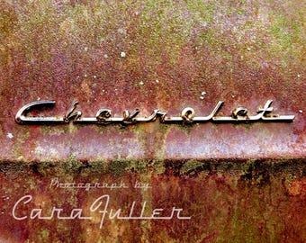 Chevrolet Emblem on Rusty Truck Photograph