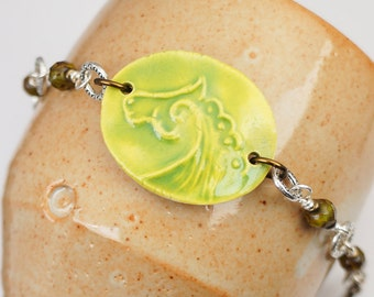 Chartreuse horse bracelet, green yellow, mixed metal brass and silver, faceted glass beads, 7 1/2 inches long 19cm