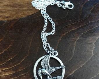 Small Silver Bird With Arrow Circular Necklace