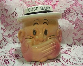 A Man's Head Cuss Bank
