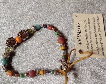 Glass bead bracelet, size SMALL. Earthtone mix. Silver findings, dog or cat paws, Boho, hippie, fair trade, gift, free shipping. Made in USA